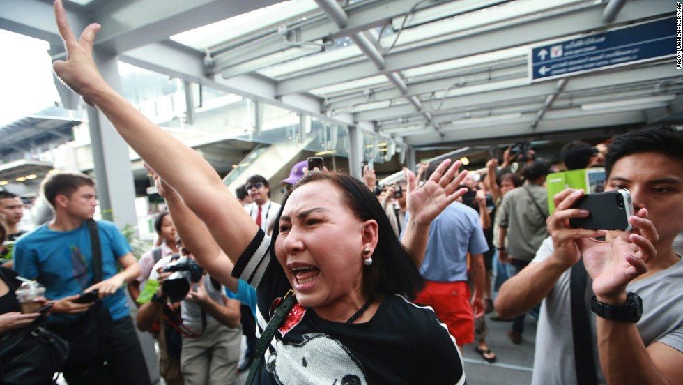 Protesters flash the three-finger salute while shouting during an anti-coup demonstration in Bangkok on Sunday, June 1.
