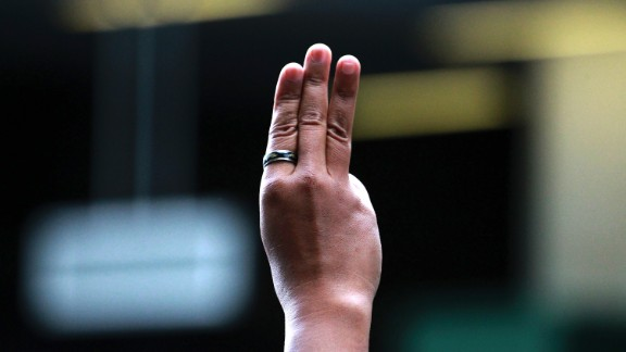 A protester holds up three fingers during an anti-coup demonstration at a Bangkok shopping mall on June 1.
