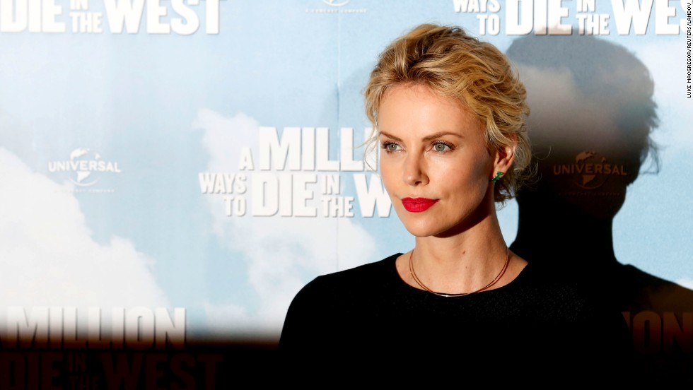 "Theron looked decidedly more pulled together during a photo call for the film ""A Million Ways to Die in the West"" in London in May 2014."