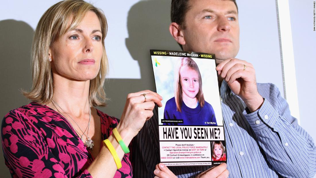 Kate and Gerry McCann hold an age-progressed police image of Madeleine during a news conference in London to mark the 5th anniversary of her disappearance in May 2012.