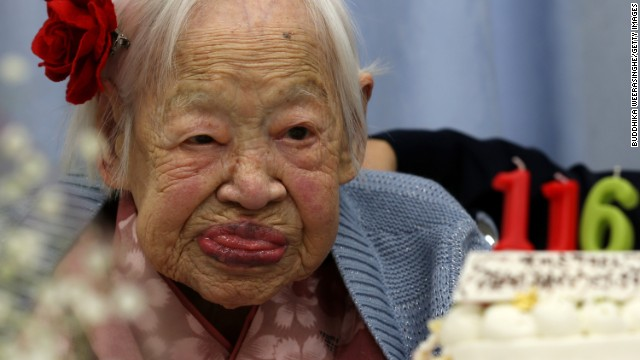 OSAKA, JAPAN - MARCH 05:  Misao Okawa, the world's oldest Japanese woman looks on her 116th birthday celebration at Kurenai Nursing Home on March 5, 2014 in Osaka, Japan. Okawa, born in Tenma, Osaka, on March 5, 1898 to a family of Kimono merchants, married in 1919 and had three children, of which a daughter and a son are still alive, and has four grandchildren and six great-grandchildren.  (Photo by Buddhika Weerasinghe/Getty Images)