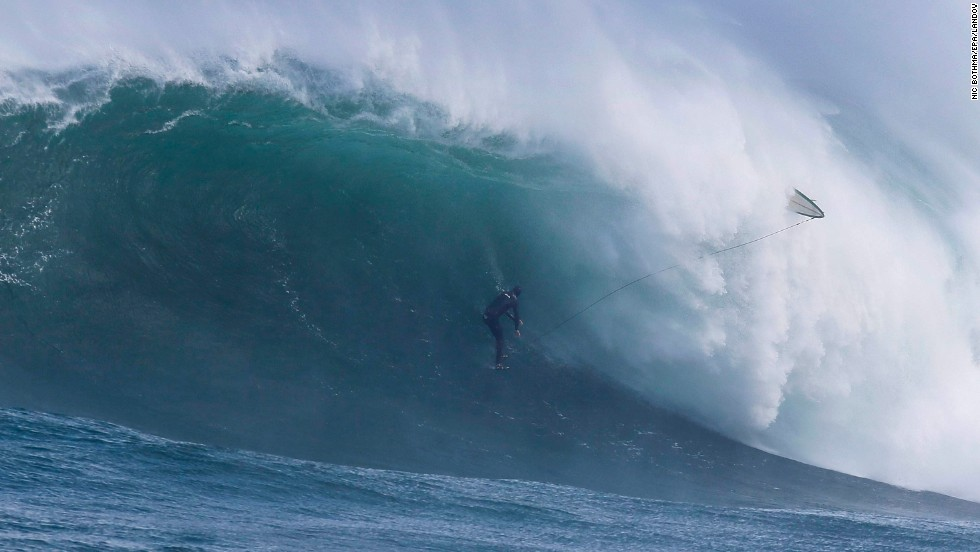 Surfer Mike Schlebach wipes out while trying to ride a wave Thursday, May 29, at an offshore reef known as Dungeons in Cape Town, South Africa. Professional big wave surfers are training for the Dungeons Challenge, which will take place before the end of August.