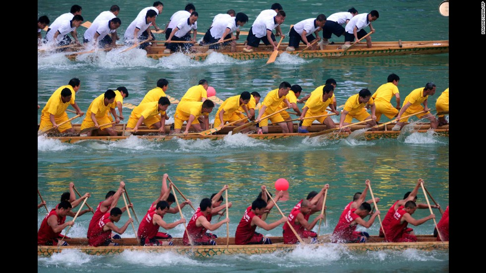 Teams race their dragon boats on a river in Tongren, China, on Sunday, June 1. Dragon boat races were held across China to celebrate the annual Dragon Boat Festival, which traditionally falls on the fifth day of the fifth lunar month.