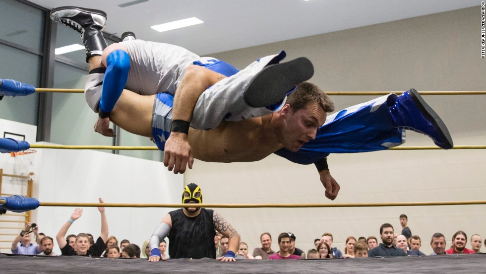 Pro wrestler Maik Tuga, bottom, fights Nacho Libres during a Swiss Championship Wrestling event held Saturday, May 31, in Zollikofen, Switzerland.