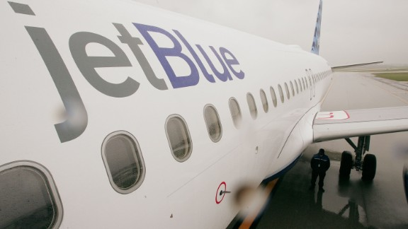A JetBlue passenger claims that her tweets got her removed from a flight.
