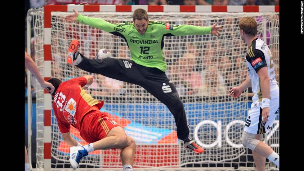 Renato Sulic of Hungarian club MKB Veszprem throws the ball past Andreas Palicka of German club THW Kiel during the semifinals of the EHF Champions League, Europe's premier handball competition, on Saturday, May 31. Kiel won the match 29-26 but lost to fellow German club Flensburg in the final one day later.