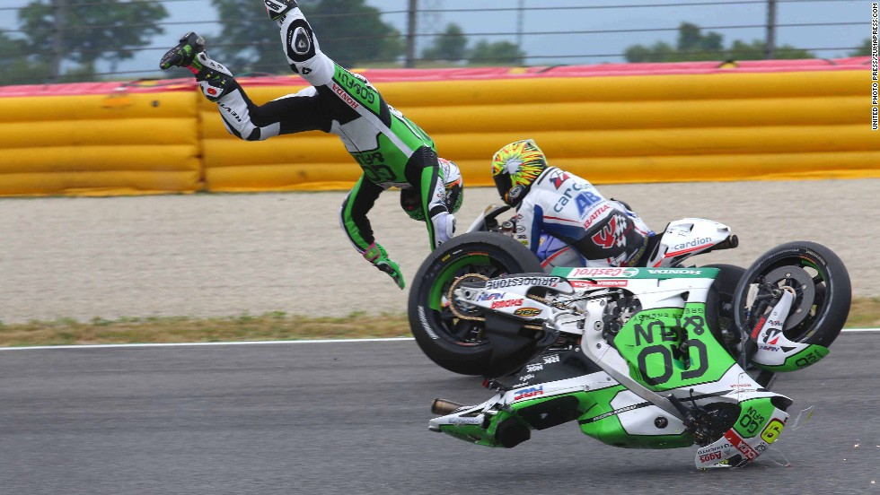 MotoGP rider Alvaro Bautista flies through the air as he falls from his bike during a practice at the Italian Grand Prix on Friday, May 30. He was not seriously injured.