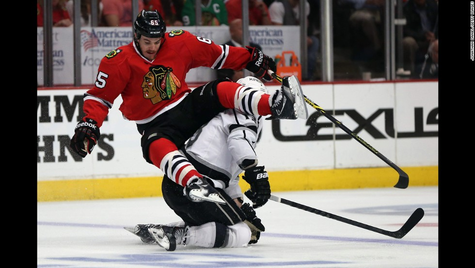 Chicago's Andrew Shaw, left, collides with Los Angeles' Kyle Clifford in Game 7 of the NHL's Western Conference finals on Sunday, June 1. The Kings won in overtime, knocking out the defending champions and advancing to play the New York Rangers for the Stanley Cup.
