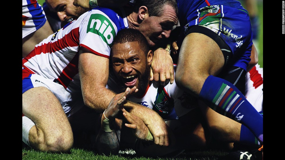 Manu Vatuvei of the New Zealand Warriors scores a try during a National Rugby League match against the Newcastle Knights on Sunday, June 1. The Warriors triumphed 38-18.