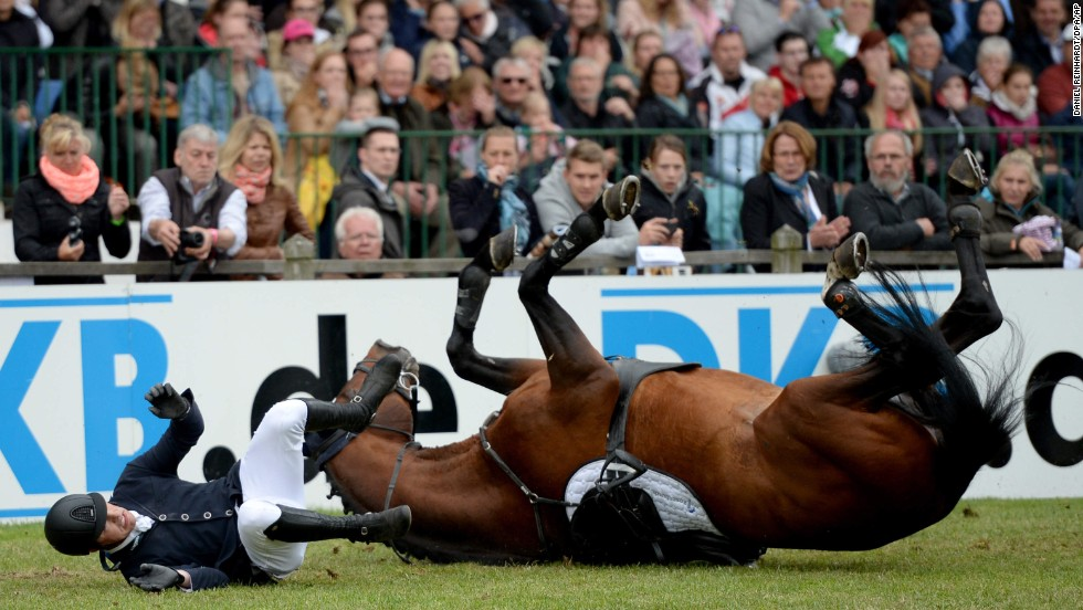 Marten Forkert and his horse, For Friendship, fall after failing to clear an obstacle at a show jumping event in Hamburg, Germany, on Sunday, June 1.
