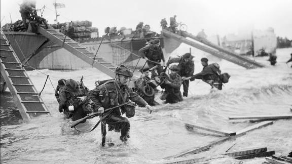 Commandos with the Royal Navy's 4th Special Service Brigade advance to Juno Beach at Saint-Aubin-sur-mer.