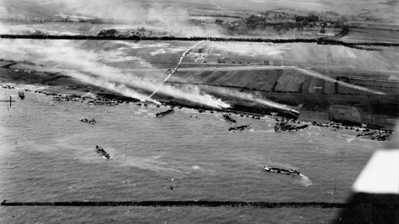 The British Army's 50th Infantry Division lands on beaches in Normandy. This photograph is part of an exhibit in London at the Imperial War Museum.