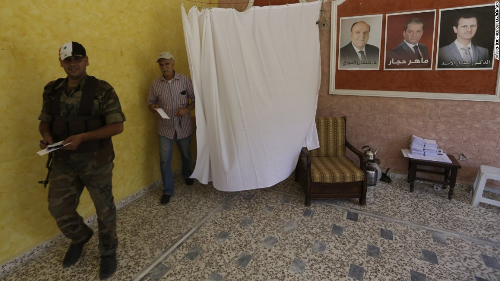 Syrians cast their votes at the Umm al-Zunnar church in Homs on June 3.
