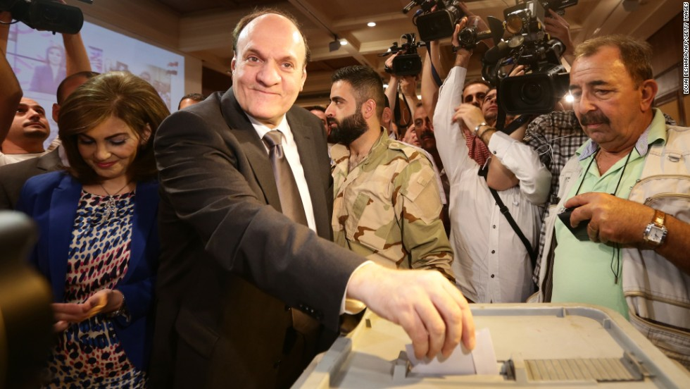 Presidential candidate Hassan al-Nouri casts his ballot in Damascus on June 3. Al-Nouri is a businessman and former government minister.