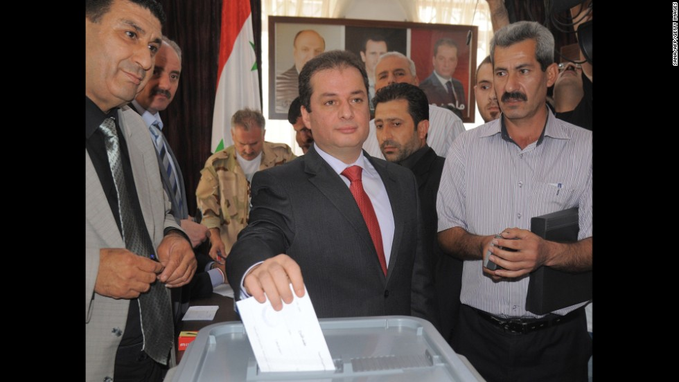 In this handout photo released by SANA, presidential candidate Maher Hajjar casts his vote in Damascus on June 3. Hajjar is a lawmaker.