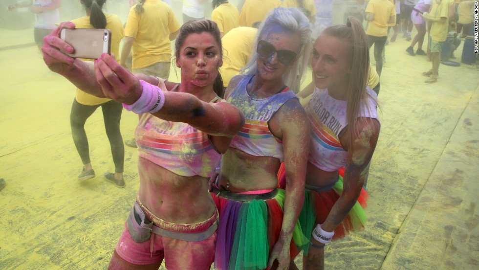 "People pose for a selfie as they take part in the Color Run in London on Sunday, June 1. The race, billed as ""the happiest 5K on the planet,"" involves lots of colored powder and takes place in different cities worldwide throughout the year."