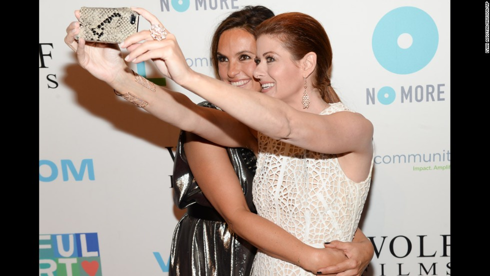 Actresses Mariska Hargitay, left, and Debra Messing take a selfie at the Joyful Revolution Gala in New York on Thursday, May 29. The event was put on by the Joyful Heart Foundation, which looks to raise awareness about sexual assault, domestic violence and child abuse and help the survivors of those issues.