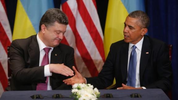U.S. President Barack Obama, right, meets with Ukraine president-elect Petro Poroshenkois in Warsaw, Poland, June 4.