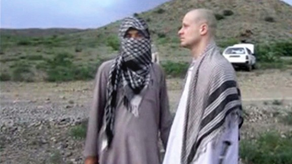 In this image taken from video obtained from Voice Of Jihad Website, which has been authenticated based on its contents and other AP reporting, Sgt. Bowe Bergdahl, right, stands with a Taliban fighter in eastern Afghanistan. The Taliban on Wednesday, June 4, 2014, released a video showing the handover of Bergdahl to U.S. forces in eastern Afghanistan, touting the swap of the American soldier for five Taliban detainees from Guantanamo as a significant achievement for the insurgents. Bergdahl was freed on Saturday after five years in captivity, and exchanged for the five Guantanamo detainees who were flown to Qatar, a tiny Gulf Arab country which has served as a mediator in the negotiations for the swap. (AP Photo/Voice Of Jihad Website via AP video)