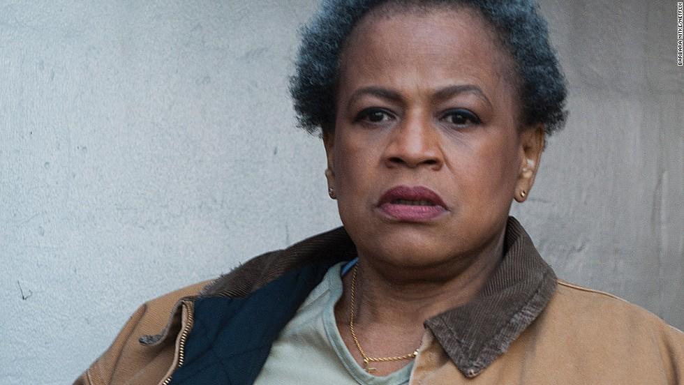 Miss Claudette Pelage (Michelle Hurst) is one of the oldest inmates at the prison. She ends up there after killing a client who abused an employee at her cleaning company. Other prisoners fear her.