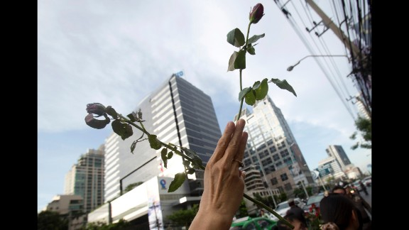 """A protester adopts the three-fingered salute from """"The Hunger Games"""" during an anti-coup demonstration in front of the Australian Embassy in Bangkok on June 4."""