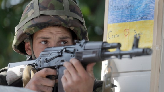 A Ukrainian soldier takes a position during a battle with pro-Russian separatist fighters at Slovyansk, Ukraine, Wednesday, June 4, 2014.