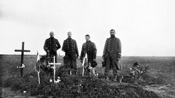Men visit the graves of French soldiers killed in the Battle of the Marne in September 1914.