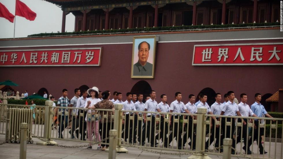 The police presence at Tiananmen Square was prominent on June 4. Plainclothes Chinese paramilitary police officers marched pass a portrait of the late leader Mao Zedong.