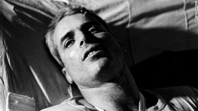 This picture taken in 1967 shows McCain lying on a bed in a Hanoi hospital.