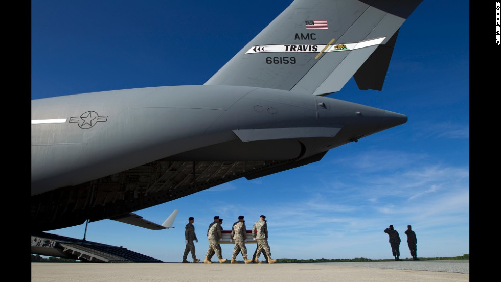 "U.S. soldiers transfer the remains of <a href=""http://www.denverpost.com/news/ci_25867236/fort-carson-gi-from-thornton-dies-afghanistan"" target=""_blank"">Army Pfc. Jacob H. Wykstra</a> after arriving at Dover Air Force Base in Delaware on Sunday, June 1. Wykstra, a 21-year-old from Thornton, Colorado, died in an aircraft accident in Afghanistan."