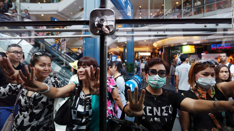 "Women flash three-finger signs at a shopping mall in Bangkok, Thailand, signaling their opposition to the country's recent <a href=""http://www.cnn.com/2014/05/19/asia/gallery/thailand-crisis/index.html"">military coup</a> on Sunday, June 1. The fingers are said to stand for freedom, equality and brotherhood."