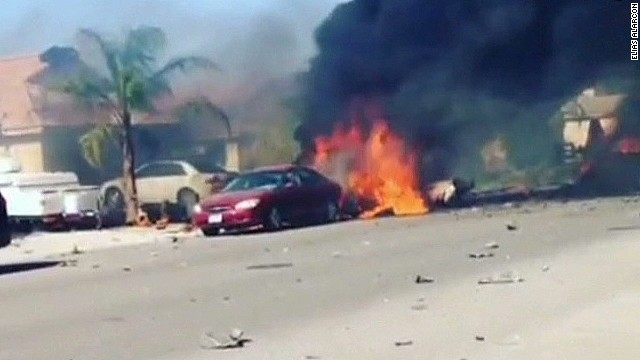Fiery military jet crash destroys homes