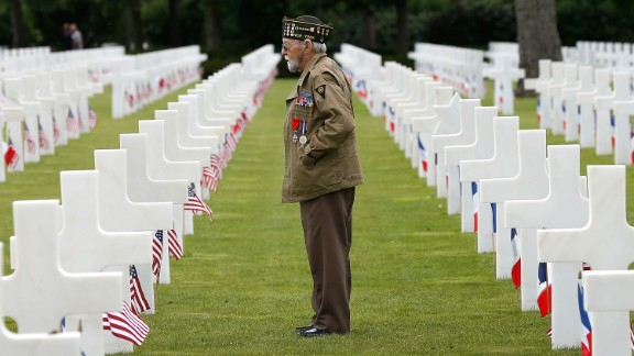 World War II veteran William Spriggs, 89, of the 83rd Infantry Division and who took part in the invasion of Normandy, searches for fallen comrades in the Normandy American Cemetery June 5, 2014 in Colleville-sur-Mer, France.