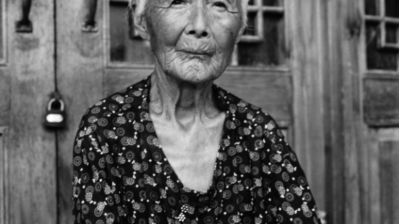 """Portrait of Zhao Hua Hong. """"There are Chinese people who criticize me for documenting bound feet. They emphasize that this is the"""