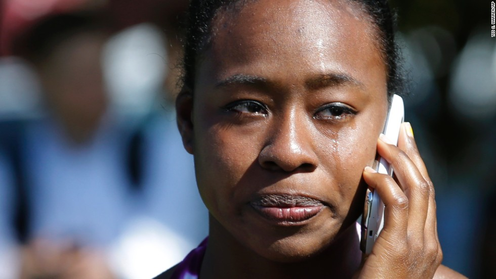 "Briana Clarke, a student at Seattle Pacific University, cries as she talks on her phone at the <a href=""http://www.cnn.com/2014/06/05/justice/seattle-campus-shooting/index.html"" target=""_blank"">scene of a shooting</a> Thursday, June 5. A gunman entered the school's science and engineering building, shot three people and was reloading a shotgun when a student subdued him, Seattle police said."