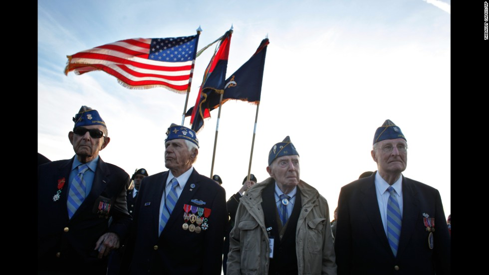 "JUNE 6 - NORMANDY, FRANCE: World War II veterans of the U.S. 29th Infantry Division attend a D-Day commemoration on Omaha Beach, where the allied forces landed 70 years ago. World leaders are taking part in the <a href=""http://edition.cnn.com/2014/06/06/world/europe/d-day-commemoration/index.html?hpt=hp_t1"">ceremonies in honor of the largest seaborne invasion in history</a>."