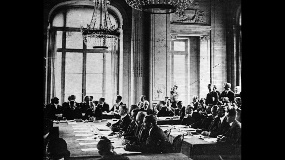 German delegates listen to French Prime Minister Georges Clemenceau