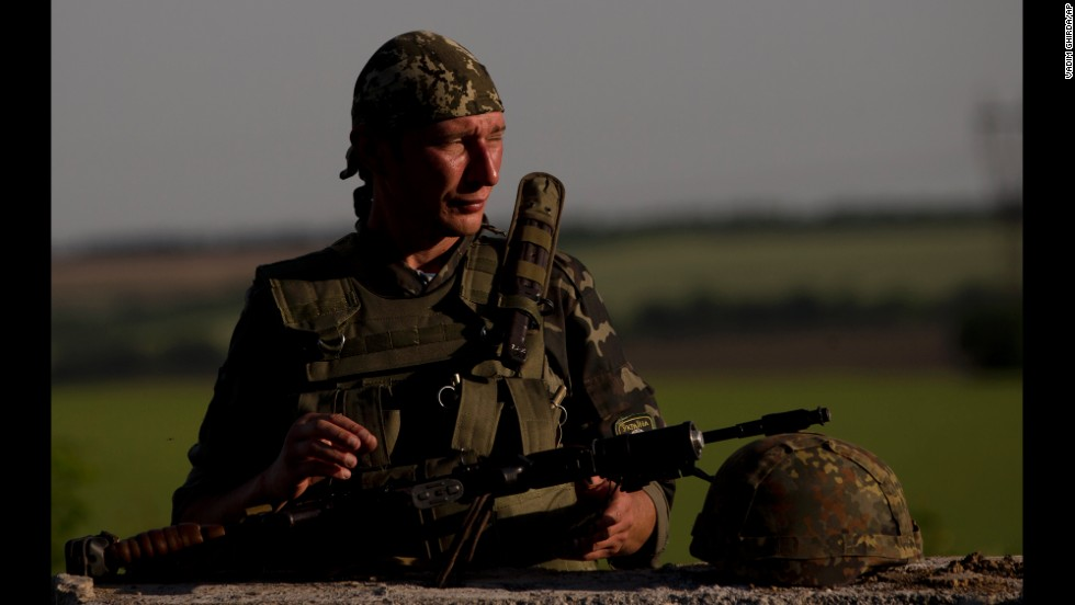 A Ukrainian soldier observes the road at a checkpoint outside of Amvrosiivka, Ukraine, on Thursday, June 5.