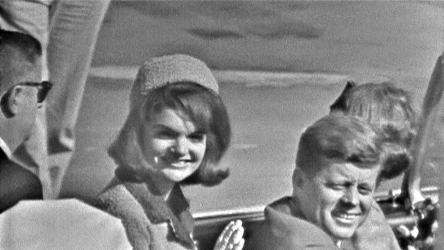 Jackie and John F. Kennedy ride in the Dallas motorcade on November 22, 1963.