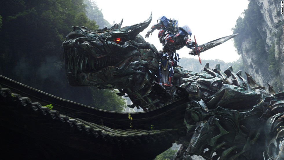 """Transformers: Age of Extinction""  features exploding cityscapes, crushed cars and people, and a cruise ship being dropped on a city.  The popular Autobot Grimlock, shown here, makes his movie debut."