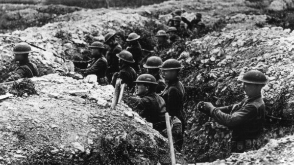U.S. Army troops stand in a defensive trench in France. By war