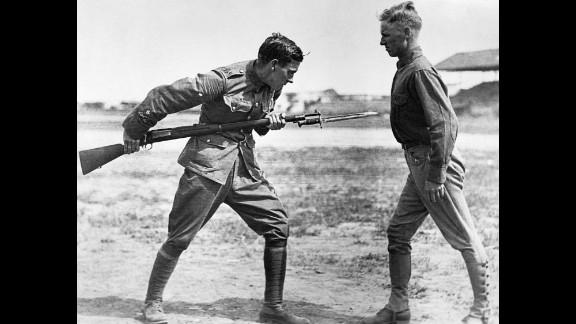 A British sergeant major instructs American soldiers in bayonet fighting at Texas
