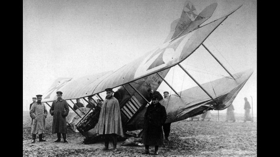 German soldiers stand near a crashed fighter plane in Germany in 1916.