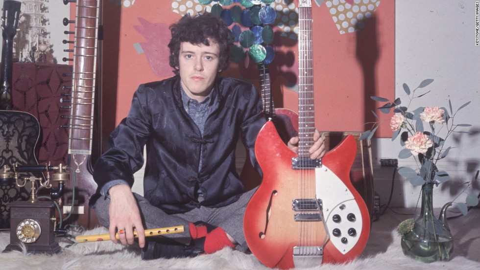 "Donovan holds his Rickenbacker guitar. He sang a mixture of folk and blues with wistful lyrics that captured the mood of the love generation. He recorded ""Catch the Wind"" when he was just 18."
