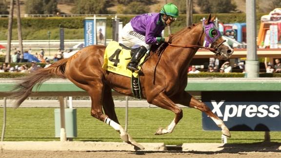 Jockey Victor Espinoza, seeking win the Triple Crown with California Chrome, rides the horse during the San Felipe Stakes at Santa Anita in March.