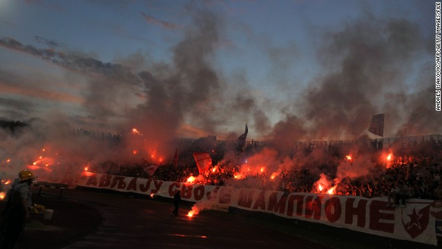 Fans of Red Star Belgrade light flares in support of their team but could they miss out on the 2014/15 Champions League?