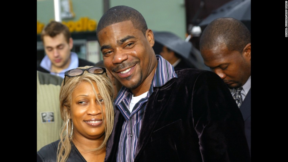 "Morgan and wife Sabina pose on the red carpet during the premiere of ""Are We There Yet?"" in Los Angeles in January 2005. The couple divorced in 2009 after 23 years of marriage."