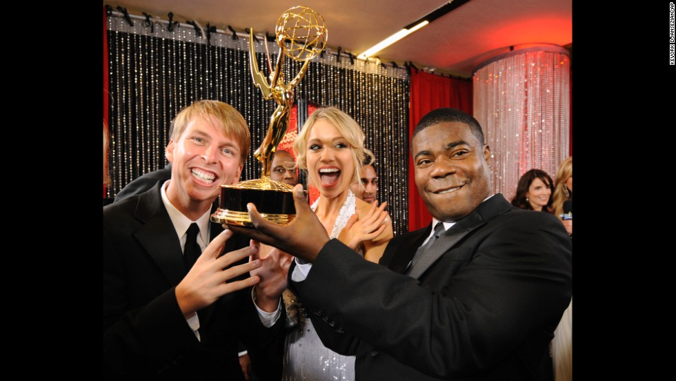 """30 Rock"" cast members joke around with their award for outstanding comedy series backstage at the Emmy Awards in Los Angeles on September 21, 2008. Morgan was also nominated for outstanding supporting actor in a comedy series."