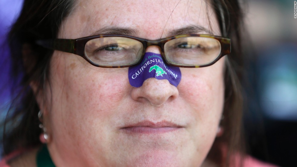 A racing fan wears a nasal strip, in honor of California Chrome, who also wears a nasal strip when he races.