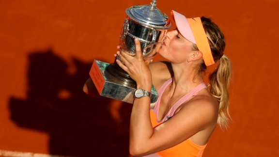 Maria Sharapova of Russia poses with the Coupe Suzanne Lenglen trophy following her victory in her women